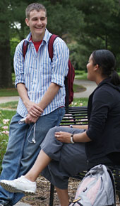 Two students talk on campus