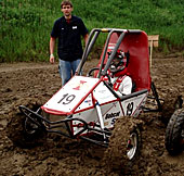Iowa State's Mini Baja Team races its machine through the mud.