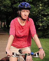 Faculty member on a bike