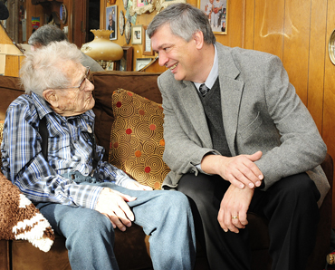 Peter Martin, director of Iowa State's Gerontology Program, with local centenarian John Persinger.