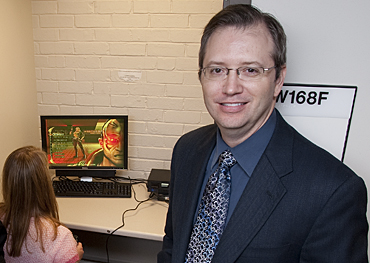 Douglas Gentile conducting video game research from ISU's Media Research Lab.