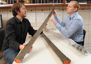 Adam Heathcote and Christopher Filstrup examine lake core samples. ISU photo by Bob Elbert