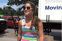 Student in front of moving van