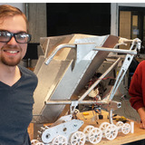 Tyler Broich and Phillip Molnar pose with the space mining robot as it is being built.
