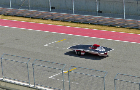 Team PrISUm's car races at the Formula Sun Grand Prix