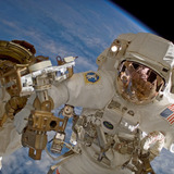 Clayton Anderson waves during a 2007 spacewalk at the International Space Station.