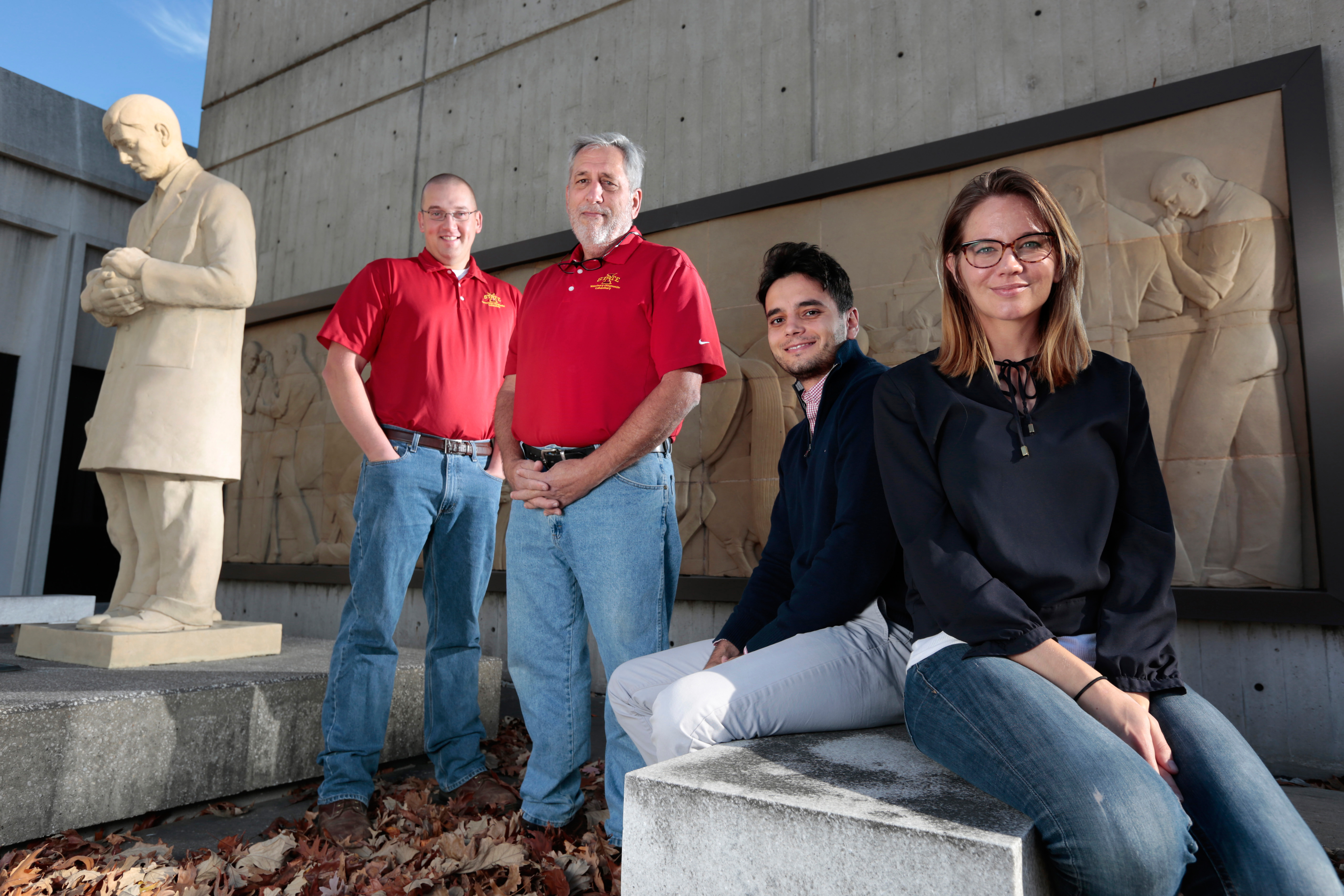 ISU veterinary researchers stand outside the College of Veterinary Medicine