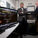"Manimaran Govindarasu and Doug Jacobson witih the ""PowerCyber"" grid security testbed."