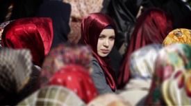 Muslim woman in a crowd