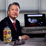 Bong Wie in his office with a model of his asteroid interceptor and a fragment from a meteorite.