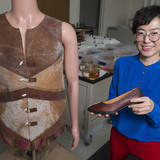Young-A Lee in the lab with vest and shot prototypes made from new fiber