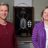 Fredric Janzen and Anne Bronikowski stand in front of a display of turtle bones.
