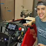 Michael Hauptmann works on this year's mini-formula racer in Cyclone Racing's campus garage.