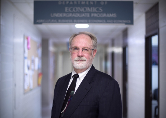 Mark Edelman stands in the ISU Department of Economics