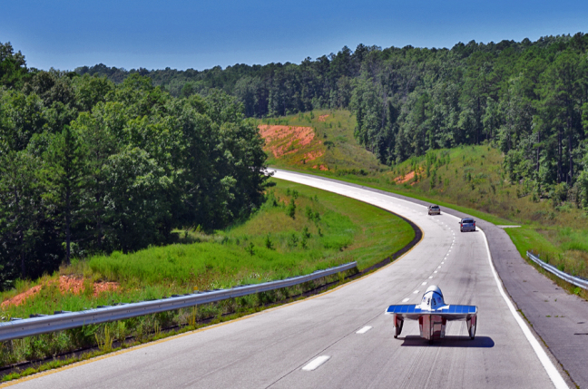 Team PrISUm's Phaeton 2 cruises down the road during the American Solar Challenge.