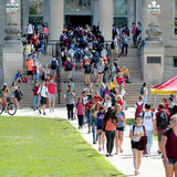 Students come and go on Curtiss Hall steps at Iowa State
