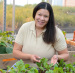 Angela Shaw tends plants in an ISU greenhouse