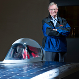 James Hill in the Team PrISUm garage with the team's latest solar racer.