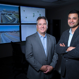 Neal Hawkins and Anuj Sharma in the big data REACTOR Lab.