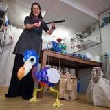 Amanda Petefish-Schrag operating dodo bird puppet
