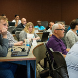 Students take notes in class for Business Analytics program