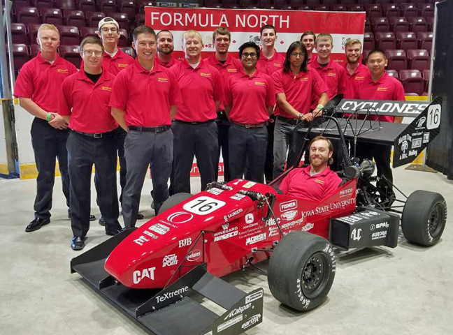 The Iowa State Formula SAE team members and their racing car at Formula North in Canada.