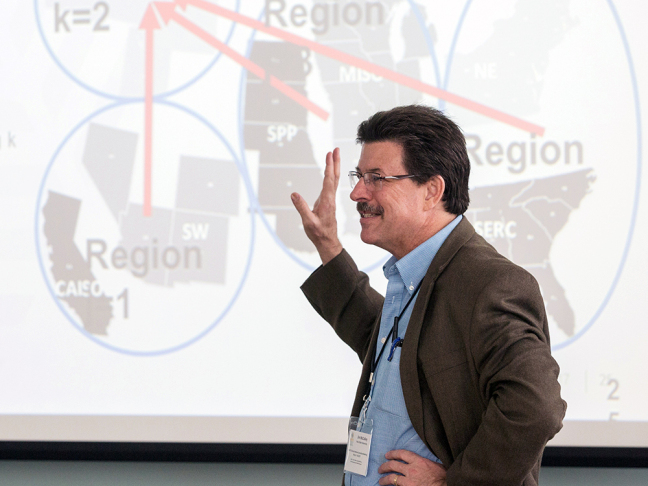 James McCalley describes his grid research during a project meeting.
