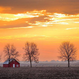 Sunrise in rural Iowa, includes a barn and hay bales