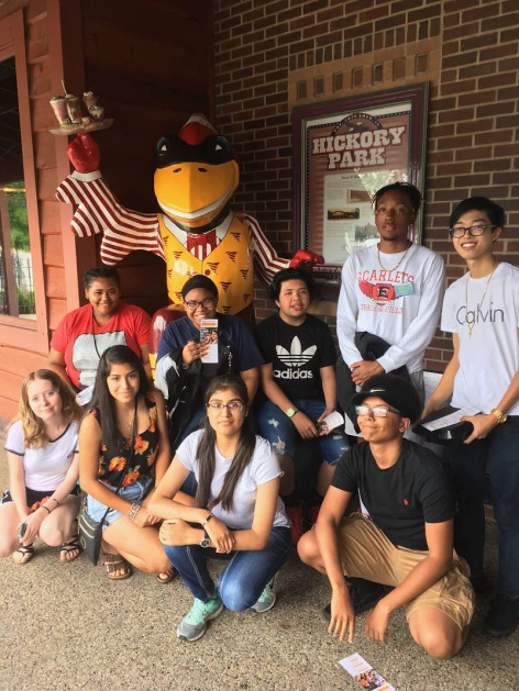 ISU 4U Promise students staying next to CY statue at Hickory Park in Ames