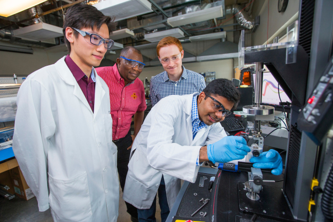 Left to right, Boyce Change, Martin Thuo, Michael Bartlett and Ravi Tutika in an Iowa State materials lab.