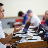 Jason Chan asks questions during a class lecture