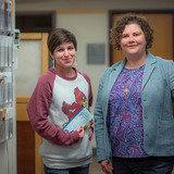 Portrait of Sara Davis and Abby Dubisar standing in clinic hallway