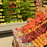 Fruits and vegetables in produce aisle of grocery store