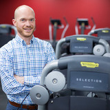Jacob Meyer standing near exercise equipment in gym