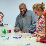 Michael Young and graduate students demonstrating math games