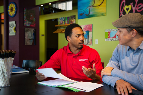 Extension program coordinator working with small business owner