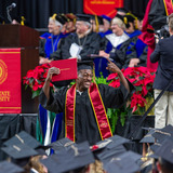 Student celebrating at commencement ceremony