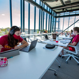 Students studying on the fourth floor of the student innovation center