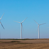 A wind farm harvests energy just north of Ames this fall.