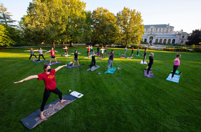 Students doing yoga on central campus
