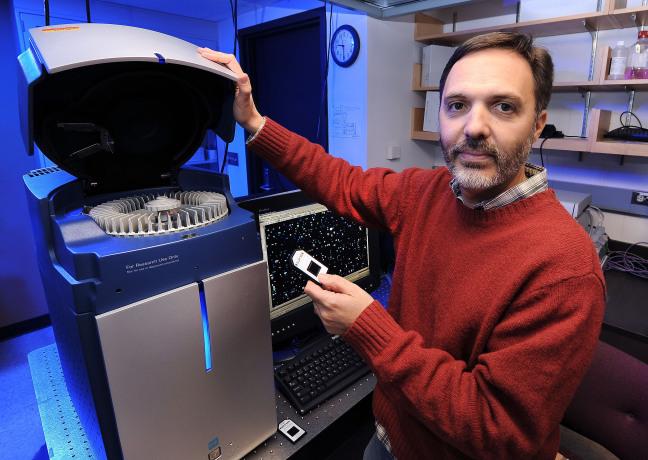 Gustavo MacIntosh operates equipment in his ISU laboratory