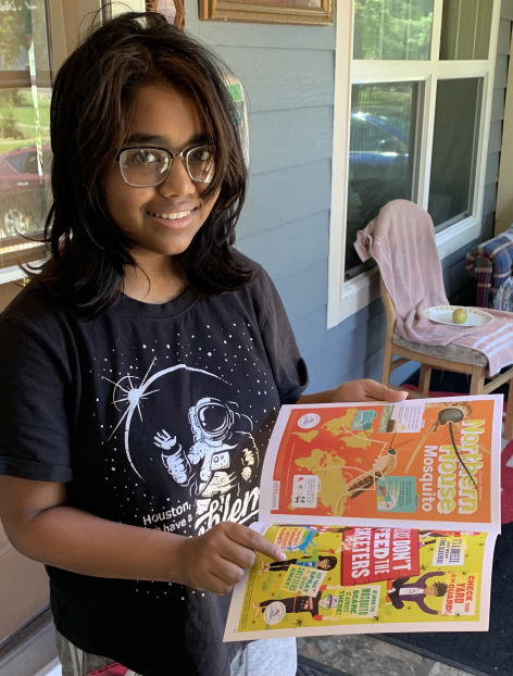 Student receiving a copy of the comic