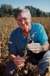 Walt Fehr in a soybean field